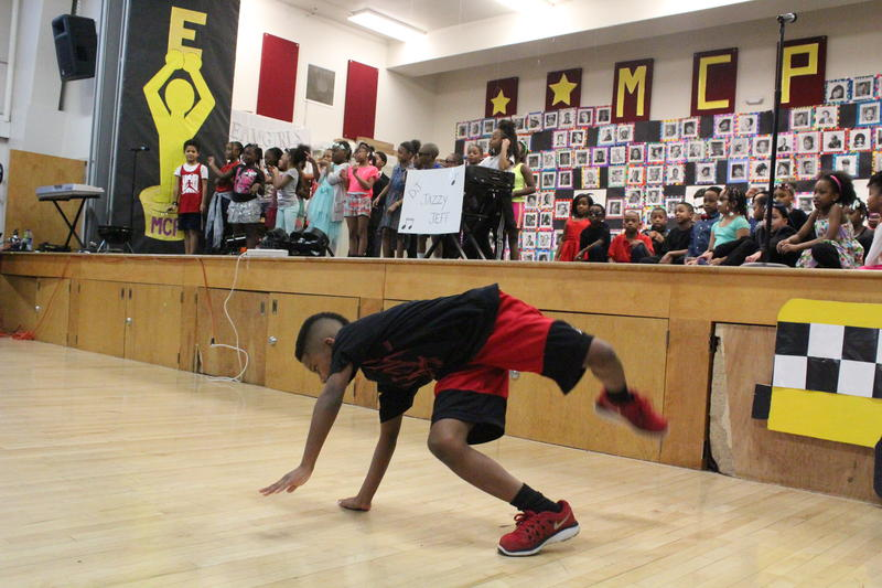 "Breaking it down: The audience claps along as this student breakdances to the tune of Will Smith's hit ""Summertime."""