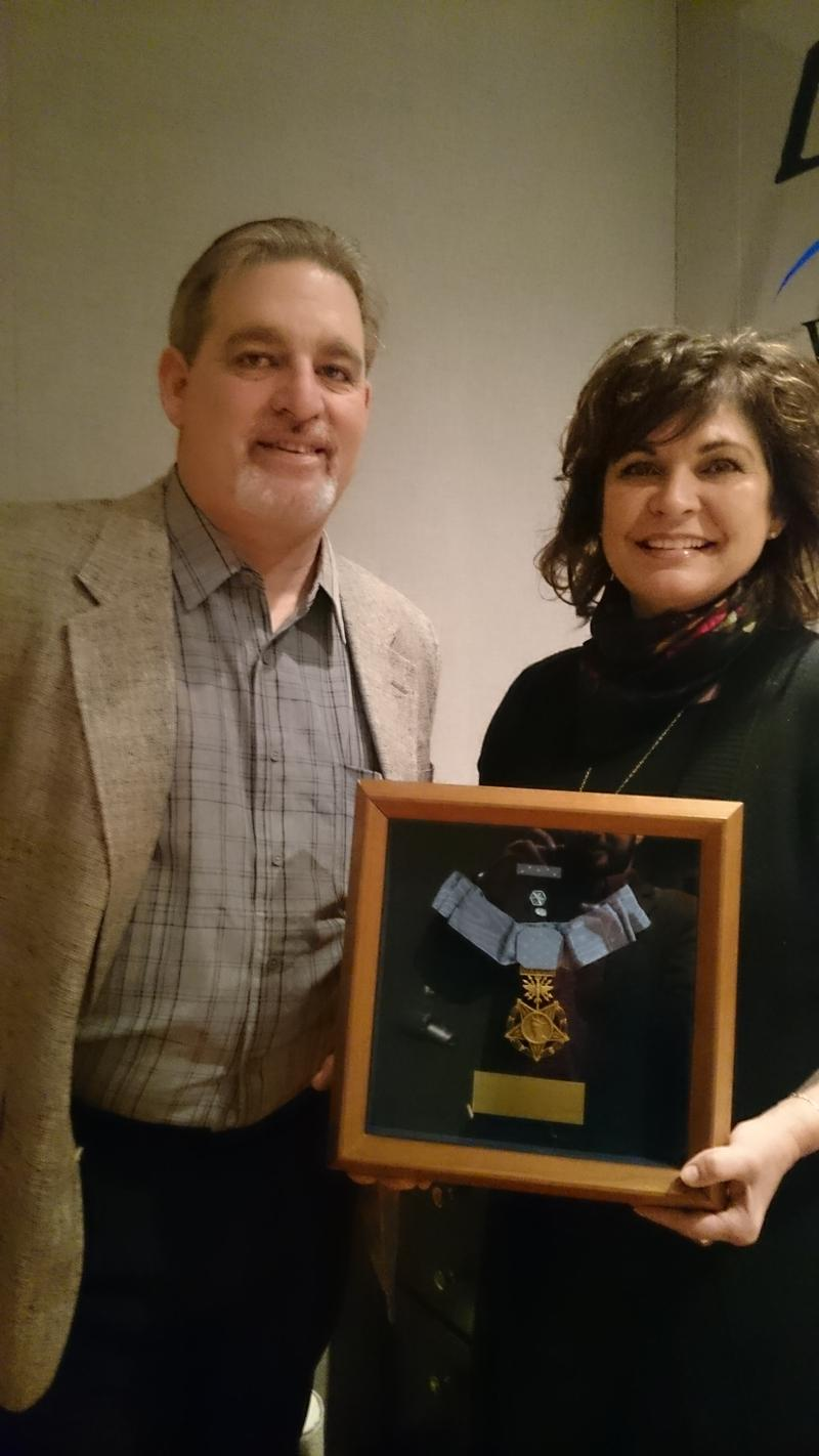 Steven Miller and Janine Sijan-Rozina with Lance Sijan's Medal of Honor in the Lake Effect studio.