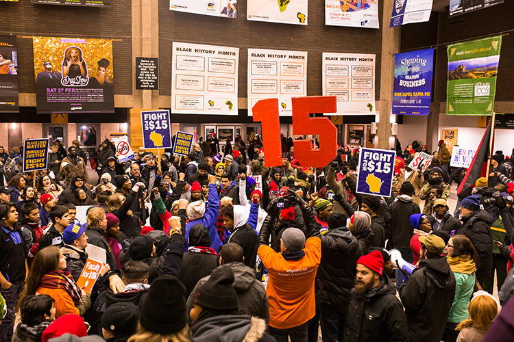Protestors calling for an increase in the minimum wage chant and bang drums in the UW-Milwaukee Union concourse during February's Democratic Debate.