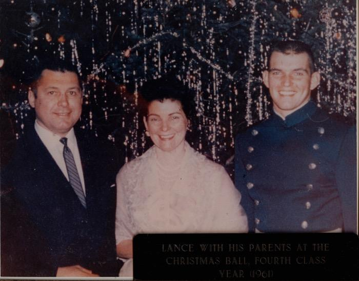 Lance (right) with his parents Syl and Jane Sijan.