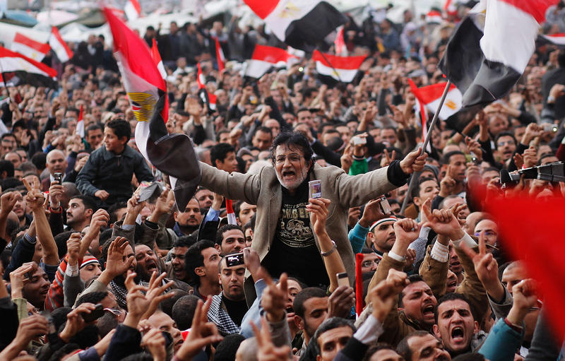 An anti-government protester is carried on shoulders in Tahrir Square in the afternoon before a speech by Egyptian President Hosni Mubarak in Tahrir Square February 10, 2011 in Cairo, Egypt.