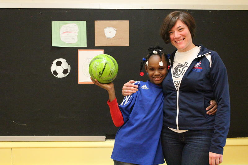 Fourth grader Pashia Bowens and her America SCORES coach, Jennifer Taff.