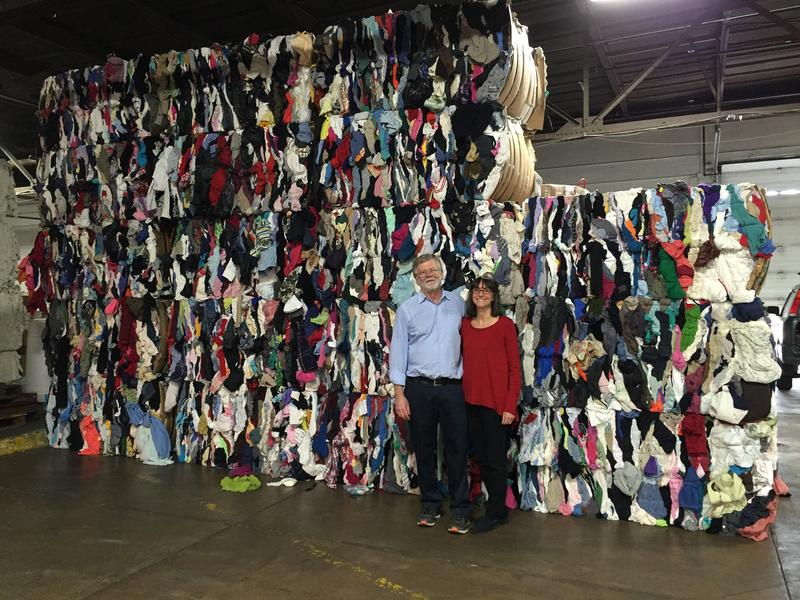 Bob and Sandy Woycke stand in front of bales of old textiles that are destined for new uses at Milwaukee Textile Recycling, a family business in Riverwest