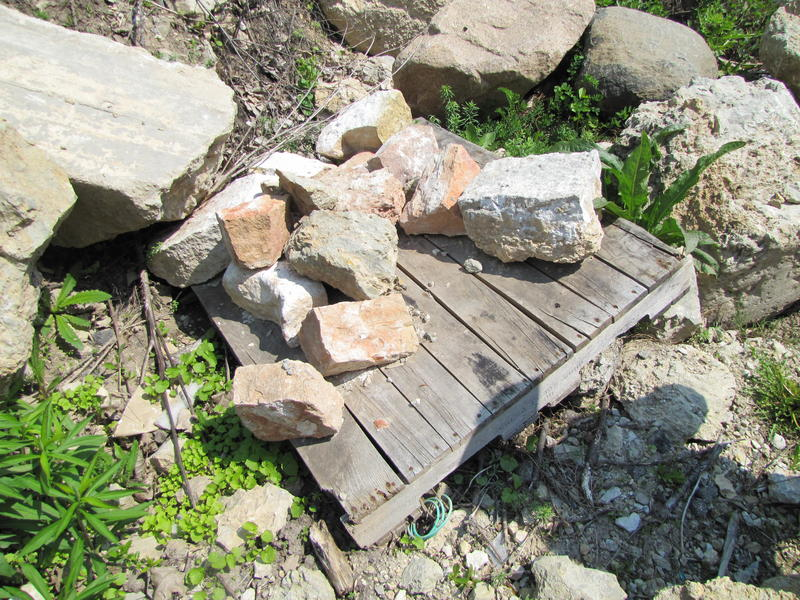 On the pallet are some of the foundation blocks of one of Schoonmaker Reef's  lime kilns.