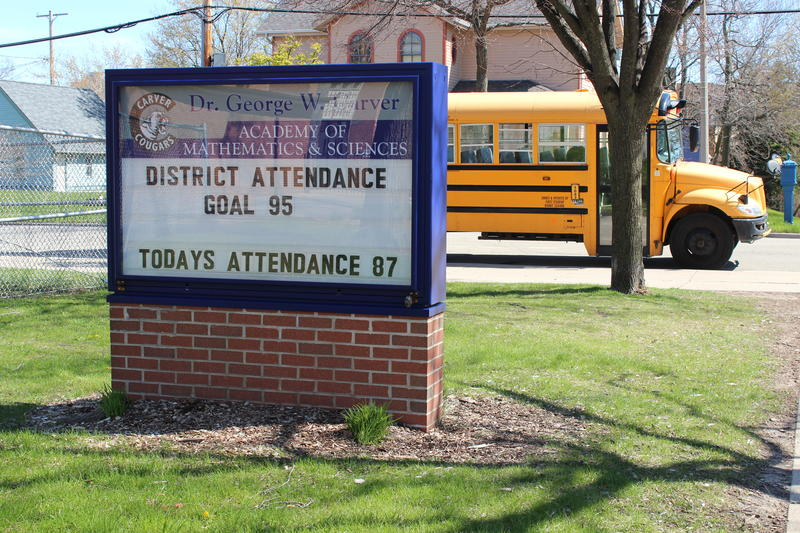 A sign outside Milwaukee's Carver Academy displays the school's daily attendance rate. Many schools around the city have started advertising attendance to encourage students to show up.