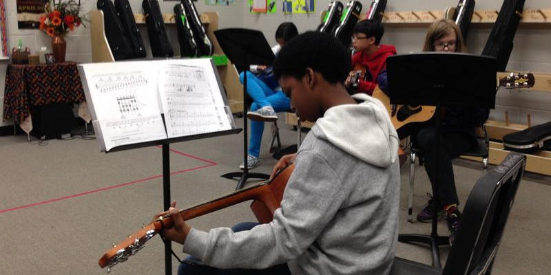 Students at Richards Middle School in Atlanta have the option to take guitar class. The school has seen a sharp increase in student attendance since making some environmental changes.
