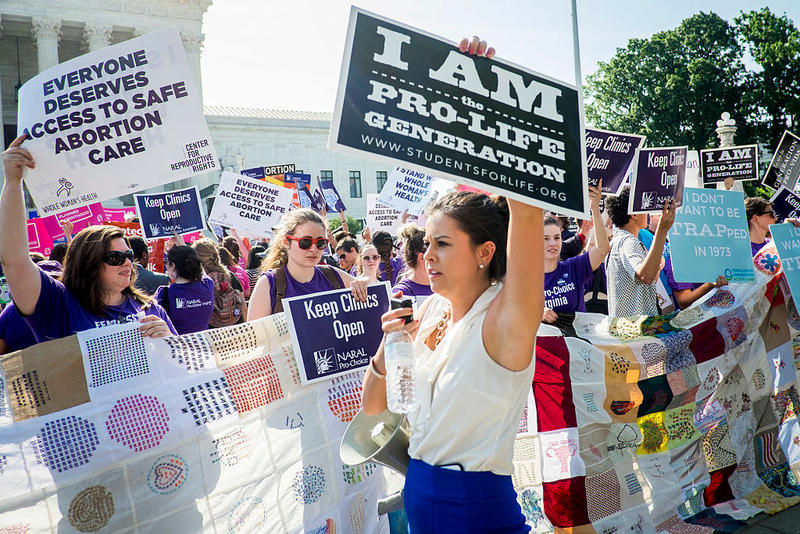 Pro-choice and pro-life activists demonstrate on the steps of the United States Supreme Court on June 27, 2016