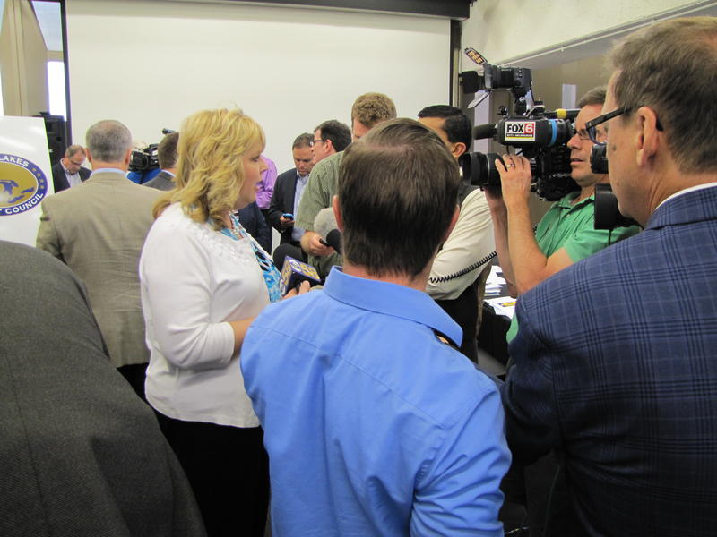 DNR Secretary Cathy Stepp talks with media after the Great Lakes Compact Council vote.