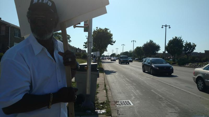 George Gage and Florence Burt picket for safer driving at the intersection of Capitol Dr. and N 60th St.