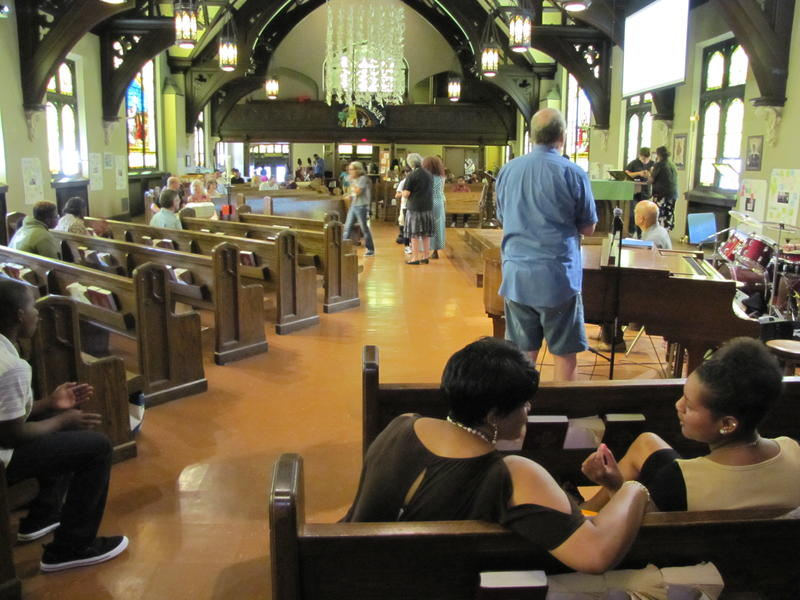 All Peoples Church congregation buoys one another with news of another family being touched by gun violence over the weekend.