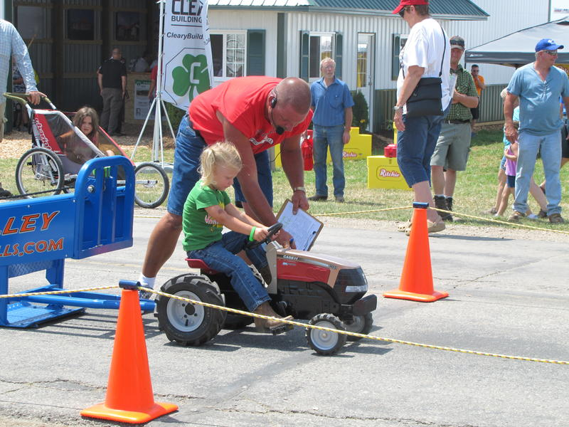 Kids get to experience a tractor pull.