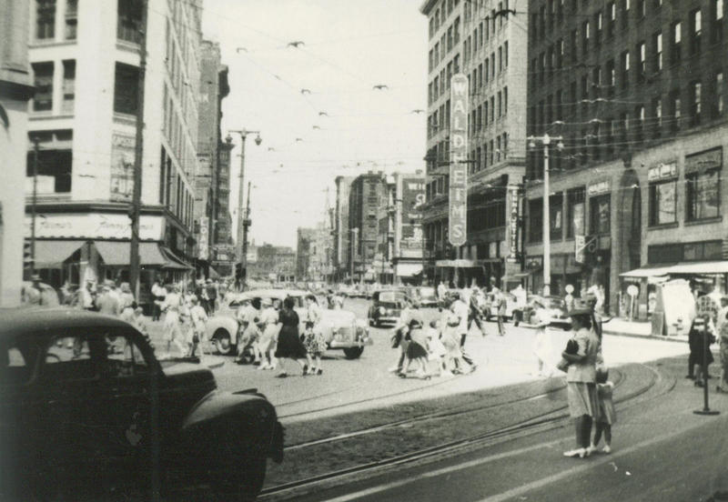 This photograph was taken in 1943 near the intersection of N. Plankinton Ave. and W. Wisconsin Ave. in downtown Milwaukee.