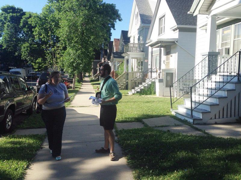 Stellar Collegiate principal Melissa McGonegle and school operations manager Patrick Mooney canvas a neighborhood for potential students.