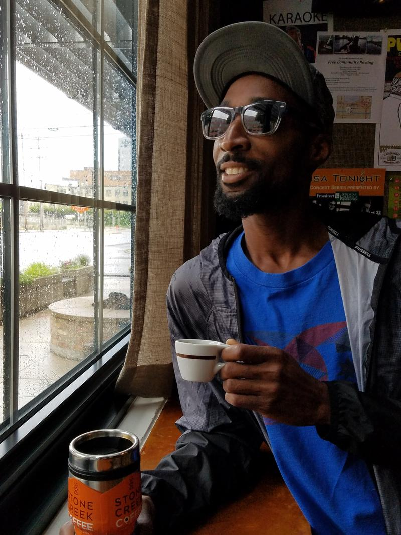 "Rahman White, aka ""Rahskol,""  with his coffee at Stone Creek Coffee in the Fifth Ward."