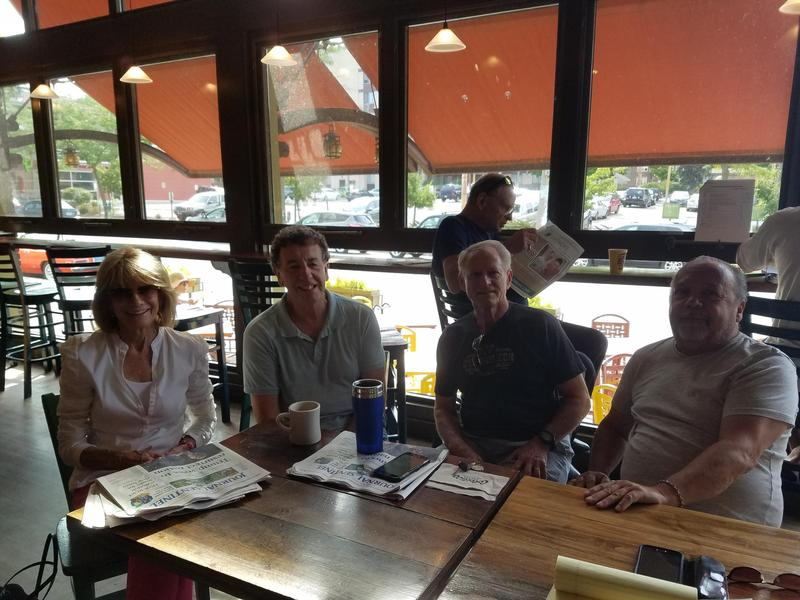 Sandra McSweeney, Trefor Williams, Lorenzo Draghicchio and Phill Modjeski (L to R) sitting at their regular spot at Colectivo on Prospect.