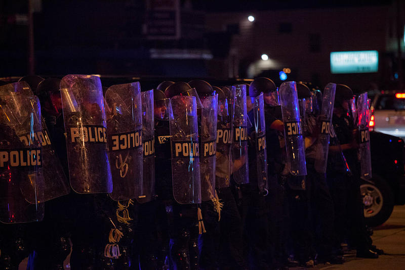 Police in riot gear line up as angry crowds took to the streets for a second night to protest an officer-involved killing August 14, 2016 in Milwaukee, Wisconsin.