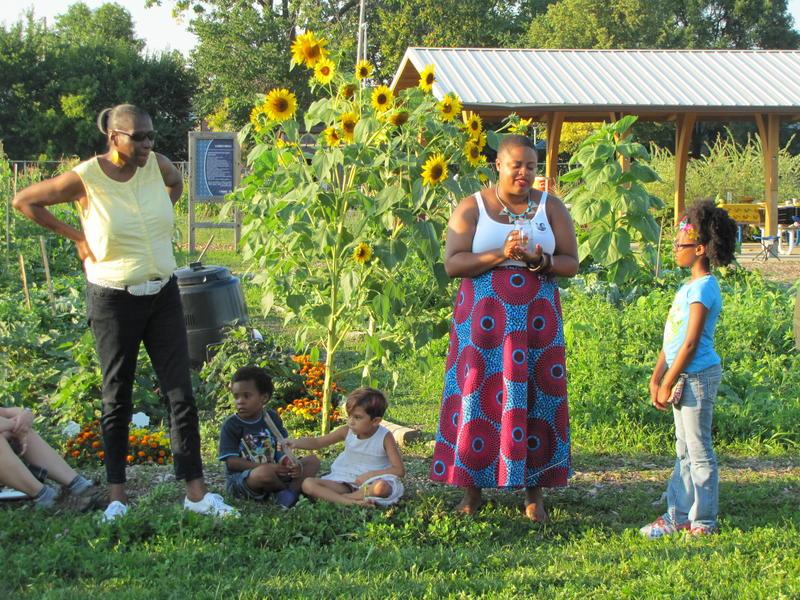 Monique Inez Liston (center) leads libation ceremony at Alice's Garden