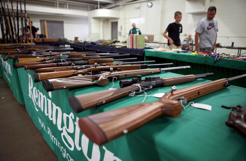 Rifles are seen on display at Ron Martin's booth at the Badger Military Collectible Show in Waukesha, Wis., on Aug. 5, 2016. Martin has been a licensed gun dealer for 33 years.