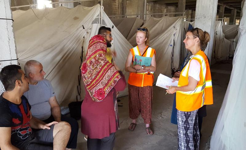 Shana Davis of Shorewood (far right) working as a volunteer at the Softex refugee camp in Thessaloníki, Greece. Sixty percent of the roughly 1,400 residents are Syrian refugees. Many live in tents inside an abandoned toilet paper factory.