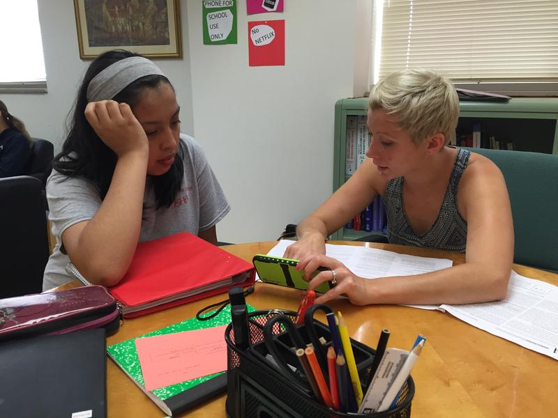 A student gets extra help from her science teacher at Milwaukee's DSHA High School.