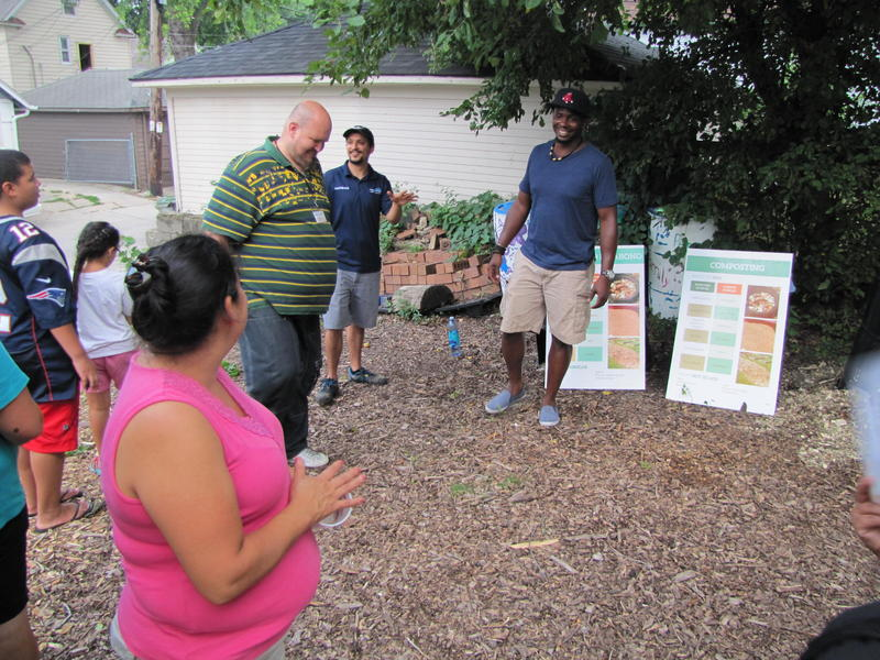 Walnut Way Conservation Corps is a project partner. Staffer Nate Gilliam (right) walks attendees through the how tos of composting at home.