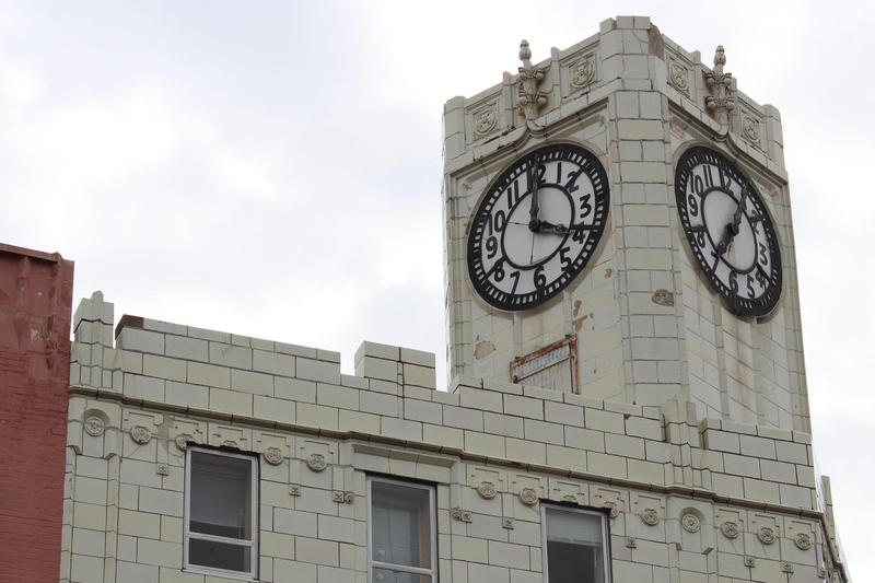 Two of three faces on a clock tower gracing the corner of Prospect and North Avenue, on Milwaukee's East Side.