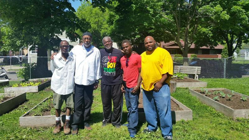 Eric Von (second in on the left) at the 'We Got This' community garden.