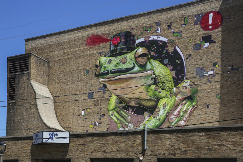 MTO's giant frog mural on the south side of the Oriental Theater