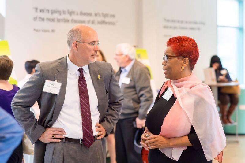 Milwaukee Succeeds' executive director Danae Davis (right) chats with attendees at an event to release her organization's annual report.