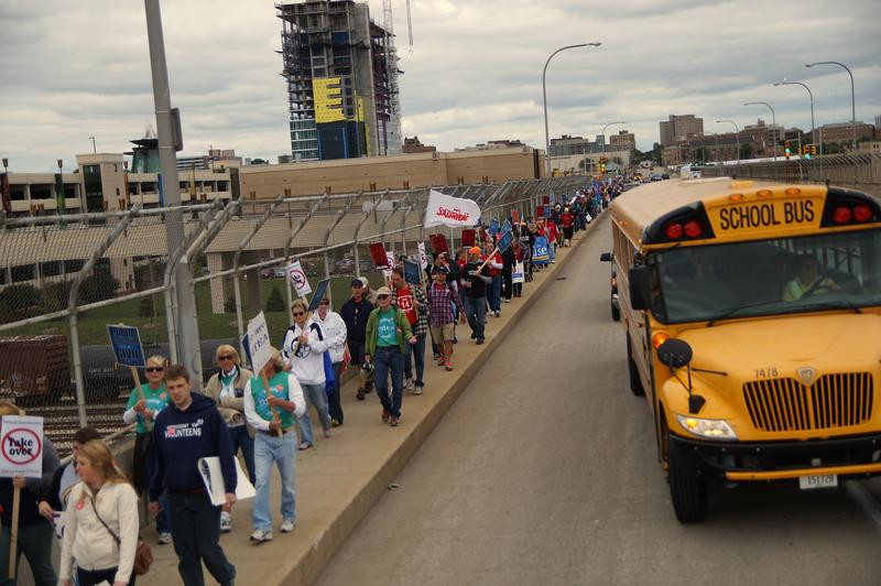 Protesters marching across the Sixteenth Street viaduct in support of public education.