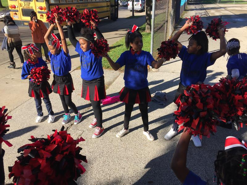 Student cheerleaders welcome their peers to a pep rally at Milwaukee College Prep's Lloyd Street campus.