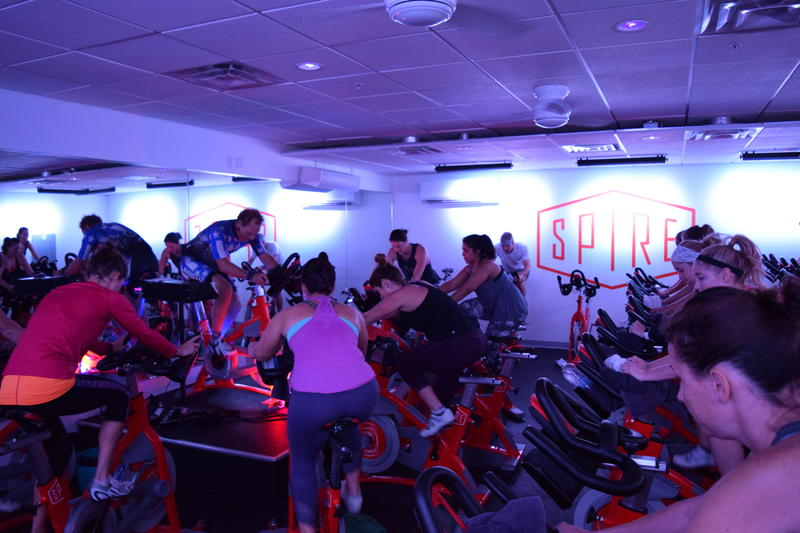Hubie Kawczyk leading a spin class at SPIRE fitness in Milwaukee.