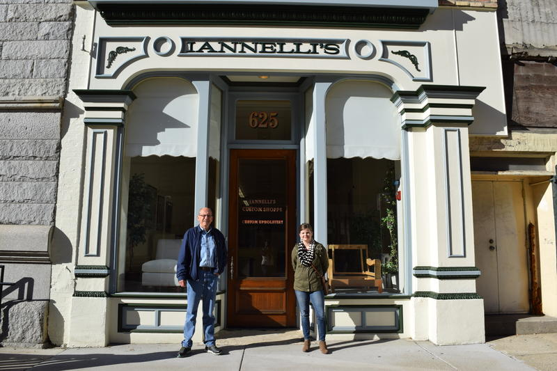 Bob Giese (left) and Emily Pauly (right) stand in front of Iannelli's Custom Shoppe, formally Marble Hall, at 625 N. Broadway in Milwaukee.