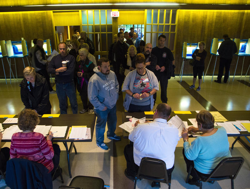 Voters wait in line at the polls to cast their ballot in the national election at Cannon Pavilion on November 8, 2016 in Milwaukee, Wisconsin.