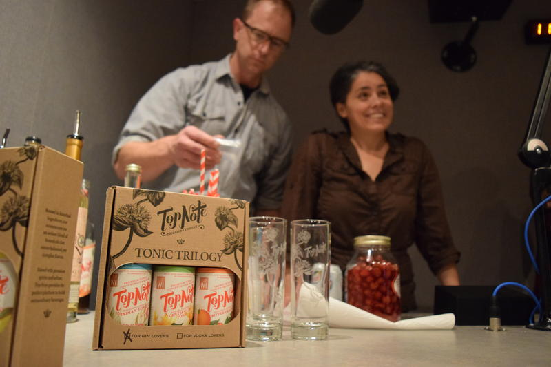 Mary Pellettieri and Noah Swanson, founder of Top Note Tonics, stirring up some drinks.