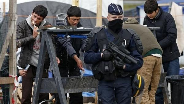 French police evicting residents of Calais Jungle in March 2016.
