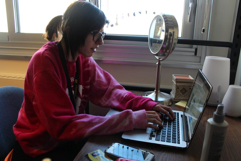 UW-Milwaukee freshman Kaylee Yelk does research for an astronomy group right from her dorm room on campus.