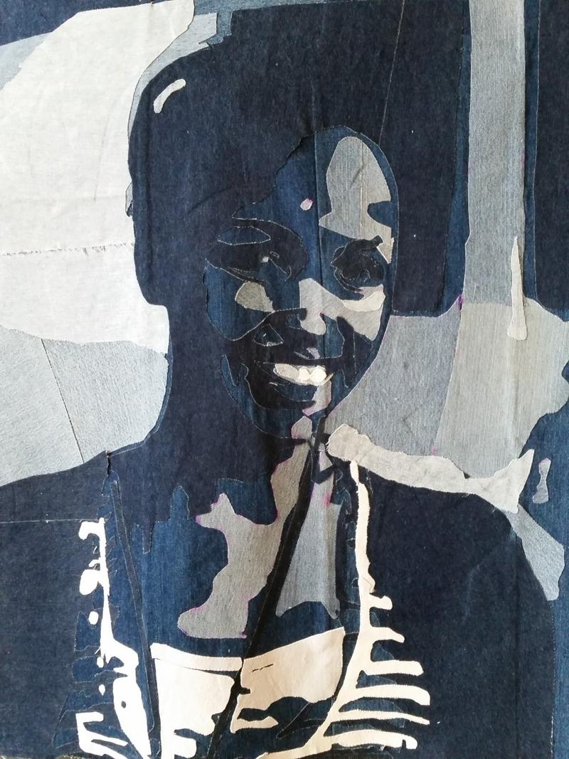 Denim portrait of Dydine Umunyana created by students from Washington High School of Information & Technology in Milwaukee.