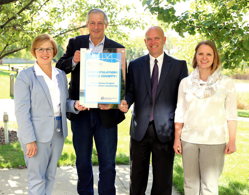 Beaver Dam receives a plaque from the Blue Zones Project.