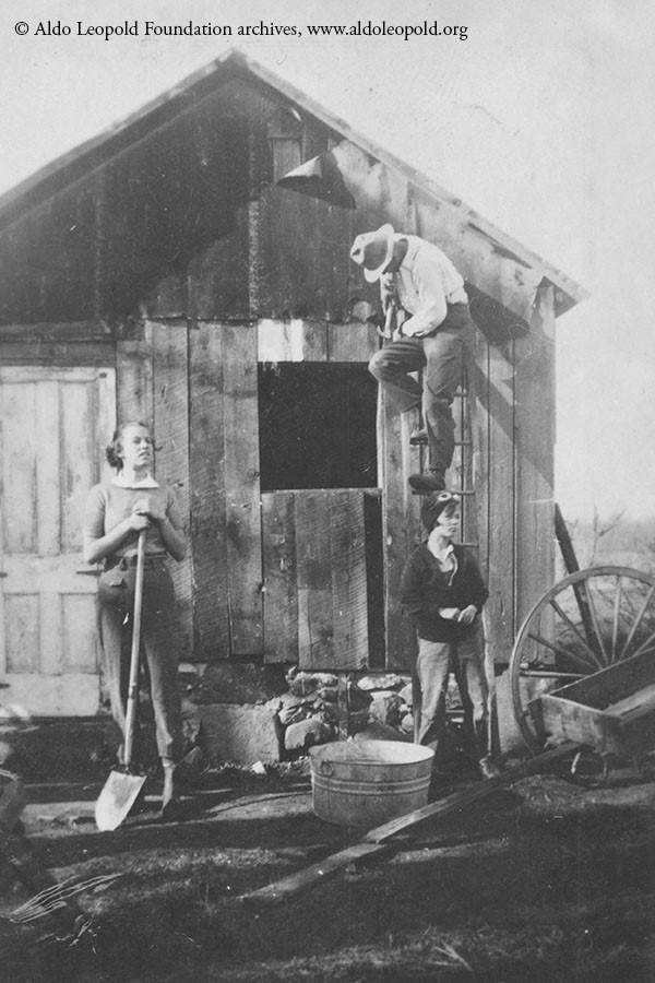 Fixing up the shack - sister Nina (left), father Aldo (above right) and Estella (below).