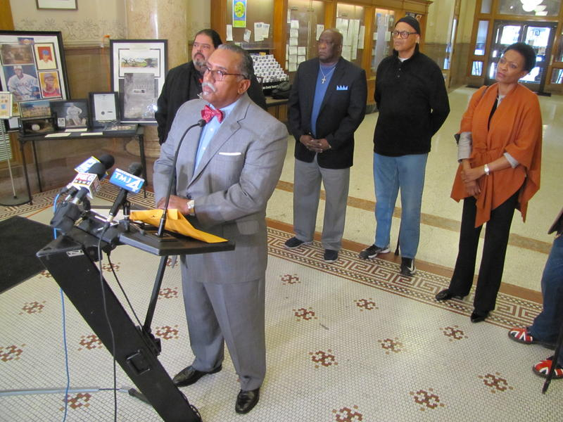 Members of the Freshwater For Life Coalition at City Hall Tuesday.  NAACP president Fred Royal at microphone.