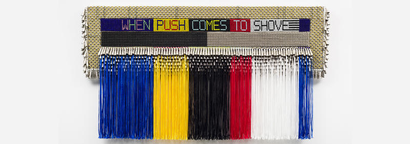 WHEN PUSH COMES TO SHOVE, 2015 , Repurposed wool army  blanket, glass beads, steel studs, nylon fringe, artificial sinew, tin jin gles, private collection, New York.