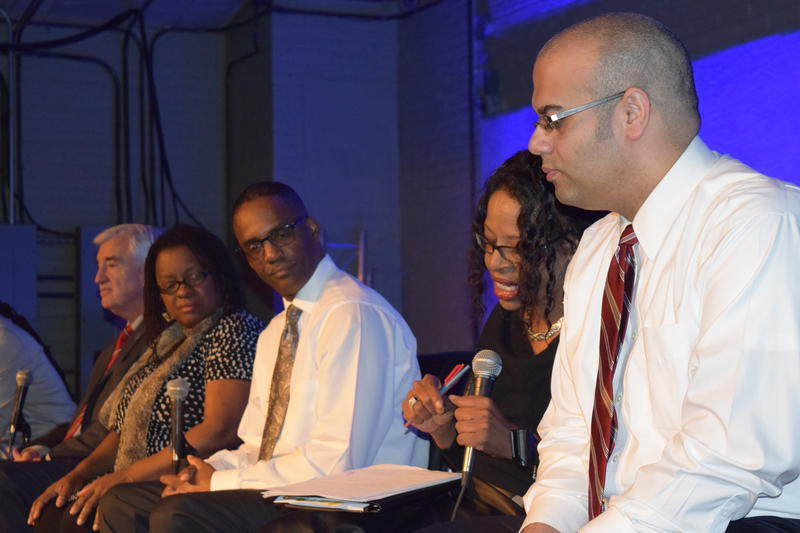 Dr. Pamela Malone speaking as other panelists listen at the Project Milwaukee: Segregation Matters live forum.