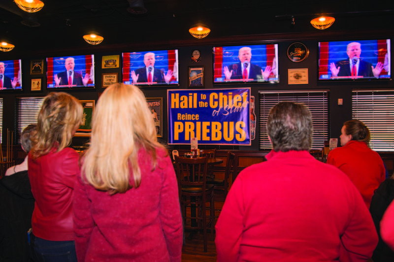 """Hail to the Chief-of-Staff"" signs and big-screen TVs hung above as friends and family of Reince Priebus gathered in his hometown of Kenosha on Inauguration Day."
