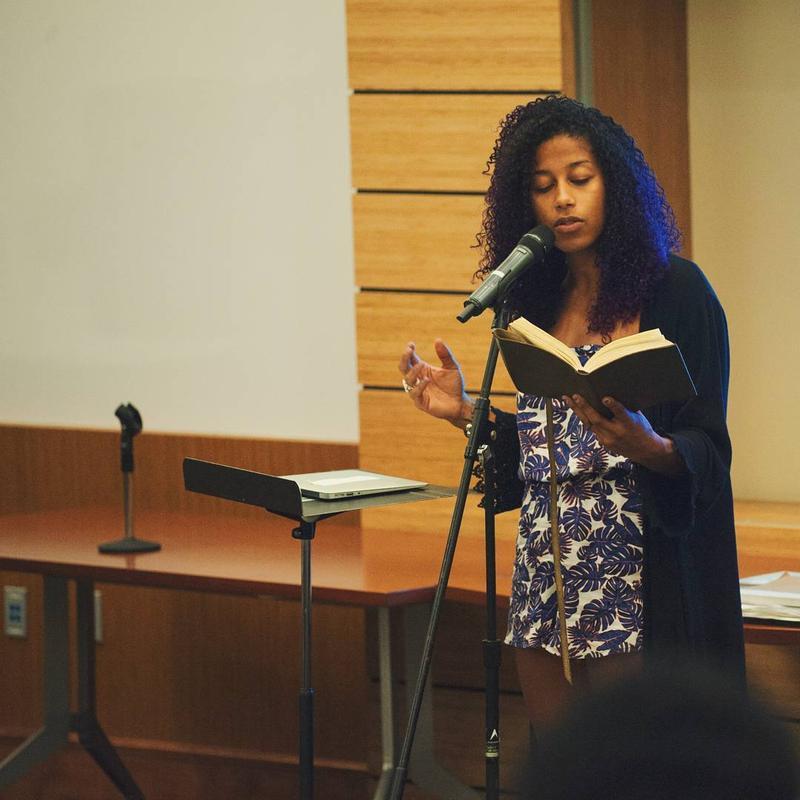 Aja Monet reading poetry.