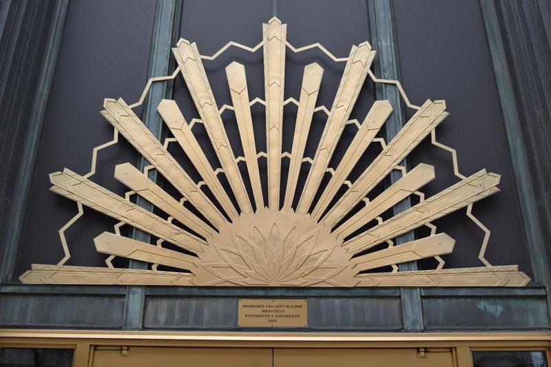 Bronze sunburst at main entrance.