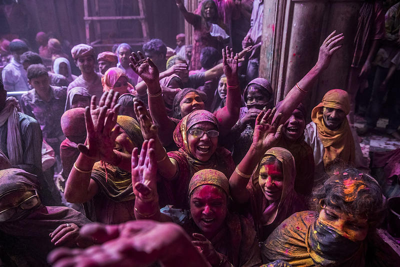 Hindu devotees play with colour during Holi celebrations at the Banke Bihari temple in Vrindavan, India.