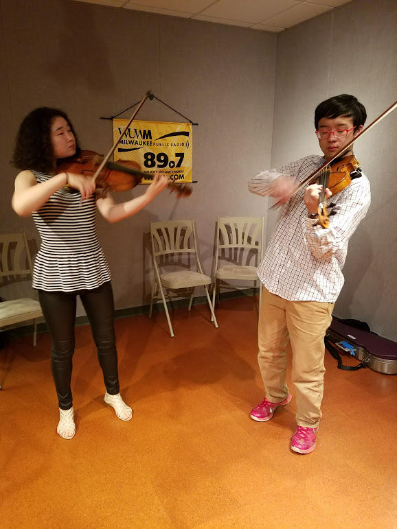 Tabby and Julian Rhee play Mozart's Sinfonia Concertante in E flat major.