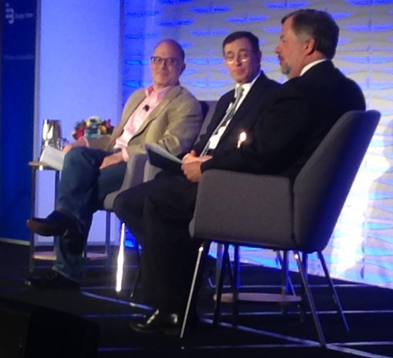 Charles Fishman (left) moderated and spoke at this year's water summit.  Here he and Seth Siegel (middle) are interviewed by Water Council president Dean Amhaus.