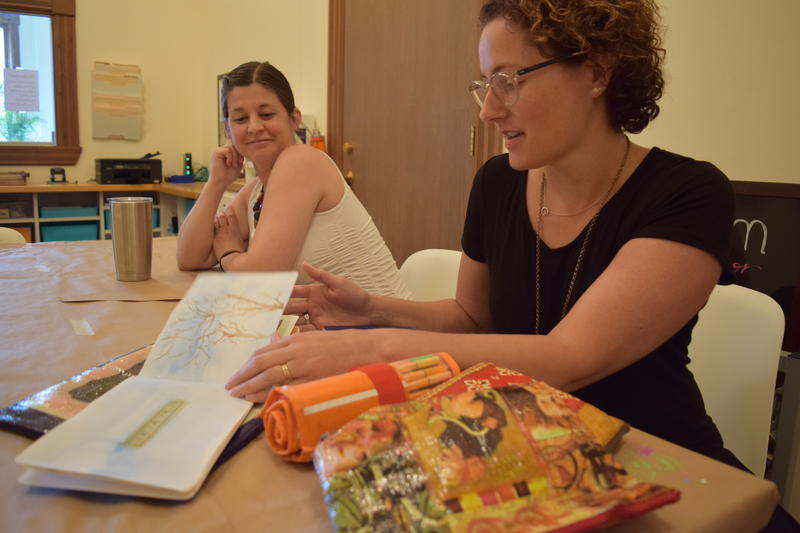 Art therapist Dr. Emily Nolan (right) keeps her own visual journal and supplies with her for often therapeutic reasons.